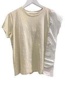 Camiseta beige con detalle blanco en el lateral