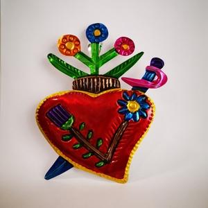 Corazón con espada y flores