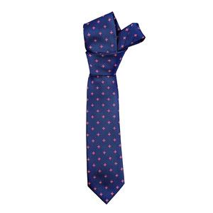 Corbata MACORI de seda en azul con flores.