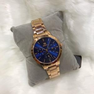 Reloj Marea dorado y esfera azul
