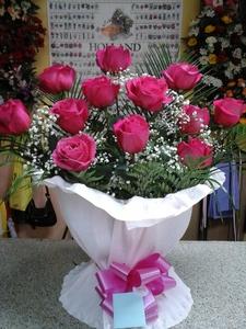 Centro 12 rosas fuxia